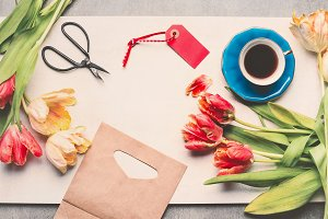 Desk with tulips and cup of coffee