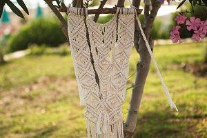Makrame hanging from oleander tree