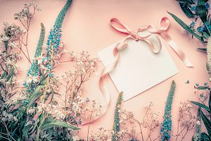 Blank card with flowers and ribbon