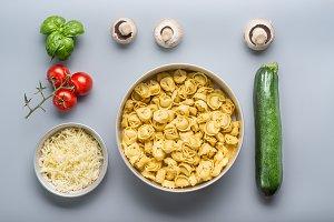 Raw Tortellini bowl with ingredients