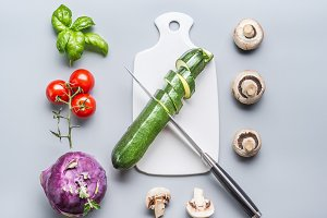 Vegetables, cutting board and knife