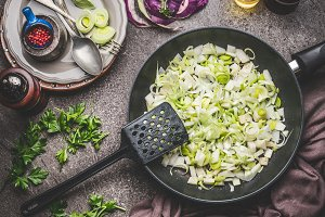 Sliced leek in frying pan