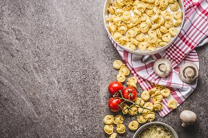 Raw tortellini pasta and ingredients