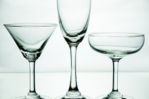 Glass of drink on white background.