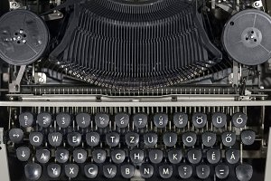 Old vintage typewriter closeup photo