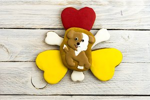 Lovely doggy and hearts on a white background. Christmas gingerbread.