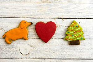 Yellow dog, red heart and Christmas tree. Attributes of the new year.