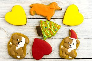 Biscuits in the form of dogs, hearts, fir trees and bones. Christmas composition.