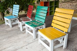 Colorful wooden chairs.