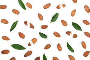 almonds with leaves isolated on white background. Flat lay pattern