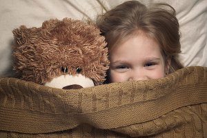 Child and toy bear