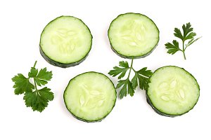 slices of cucumber with leaf parsley isolated on white background