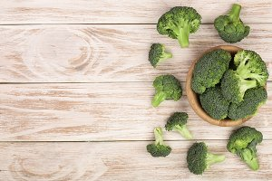 fresh broccoli on white wooden background with copy space for your text. Top view