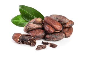 unpeeled cocoa bean with leaf isolated on white background