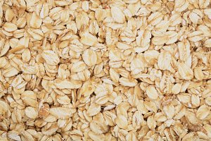 Texture of oatmeal as a background. Top view