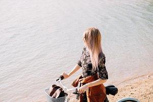 Woman near the lake with bike
