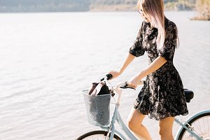 Woman near the lake with bike