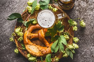 Beer with pretzel and hops