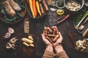 Hands  holding jerusalem artichokes