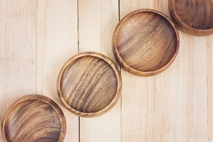 Wood bowls on a wooden background