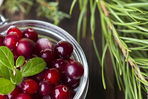 fresh cranberries on a wooden background