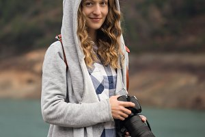 Woman photographer with long focal length lens