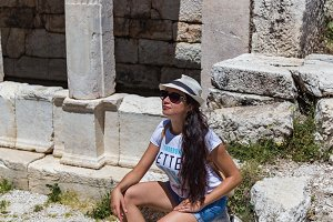 Woman traveller exploring ancient ruins