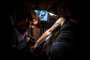 Bearded tattoo male artist