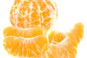 Orange peeled mandarin and slices