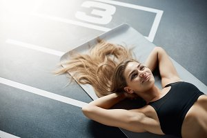 Portrait of happy adult woman after a fitness workout. Having a rest and smiling. sports concept.