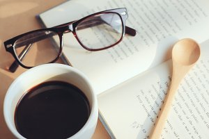 eyeglasses and book with coffee