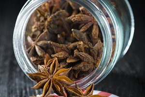 A glass jar with star anise seeds