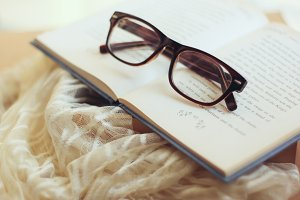 Eyeglasses and book