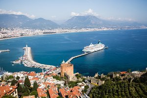Seascape with the bay of Alanya, pier, mountains and cruise ship