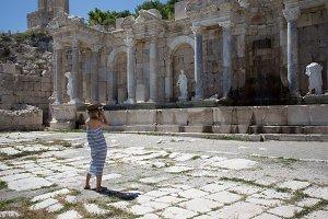 woman traveller photographing agora at ancient city of Sagalassp