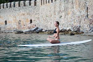 fit woman doing sup yoga