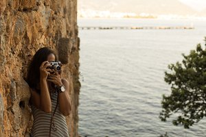 Traveller woman photographing