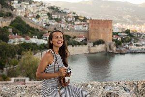 Travelling photographer with vintage camera in bay of Alanya