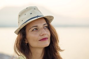portrait of woman wearing beige hat