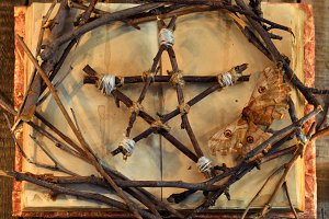 Pentagram and old book