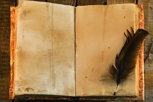 Old book and feather quill