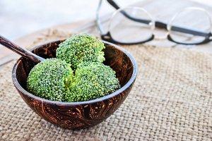 fresh broccoli in wooden bowl