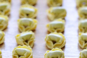 Preparing homemade tortellini on woo