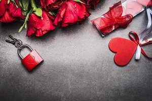 Red roses with heart, lock and key