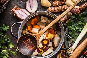 Cooking pot with root vegetables