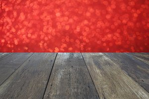 Realistic blank wooden tabletop with red blurred bokeh background - used for product display presentation during holiday season