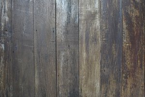 Vertically realistic brown wood texture for background