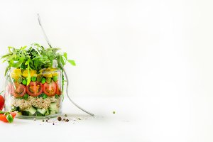 Healthy salad jar with quinoa and vegetables, cherry tomatoes, cucumber, ruccola. Raw vegetarian meal for diet, detox, clean eating. Homemade concept. Banner