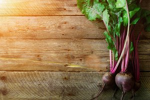 Bunch of fresh organic beetroot on wooden background. Concept of diet, raw, vegetarian meal. Farm, rustic and country style