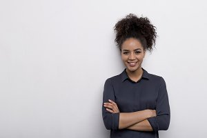 Female entrepreneur at wall